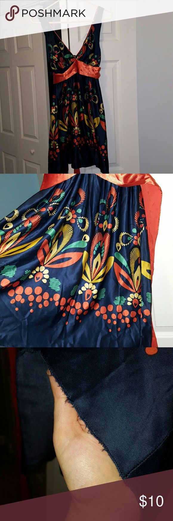 Navy party dress Navy low cut dress with orange and yellow flowers. Orange tie sash under bust. 23 inches from armpit to hem. Great going out dress for summer or fall. Small fraying at hem (see pictures). From a home with cats. Forever 21 Dresses Midi