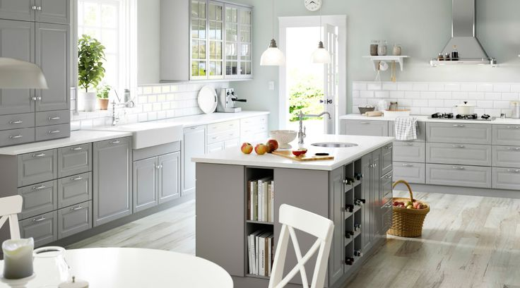 Grey and white kitchen with a kitchen island at the center.