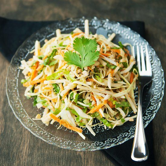 Bright and refreshing Asian slaw with a spunky ginger peanut dressing.