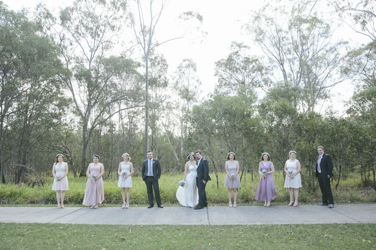 Bridesmaids in mismatched dresses in shades of blush