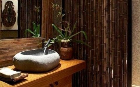 Brown Bathroom Wall With Bamboo Wall And Stone Wash Basin Mirror Lamp Towel And Carpet With Ceramic Floor