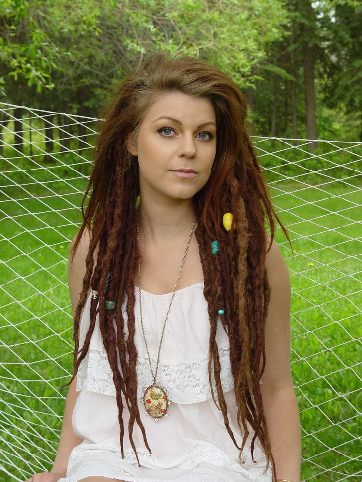 Love how hers is smooth on top and dreaded on the bottom... love the beads, too. This is exactly how I want mine done, leave a section in front undone and dread up the rest! #dread #love
