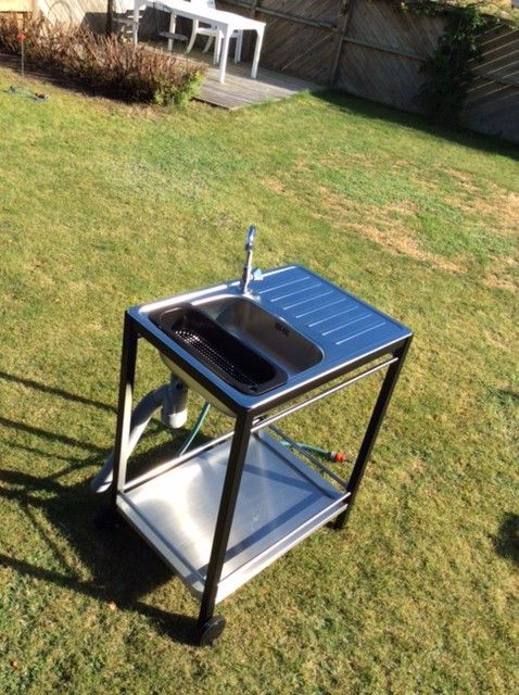Mini outdoor sink: Ikea Klasen trolley with Boholmen sink, just add hose. Could be useful in the back for rinsing veggies and tools.