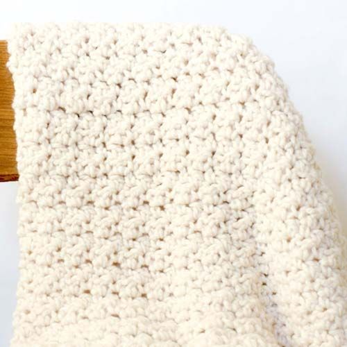 This super chunky crochet blanket is going to be your go-to blanket this coming winter – use super soft yarn for a warmer and cosier blanket. For full post click here. By: Mama in a Stitch
