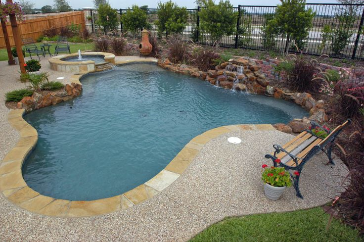 Pool and spa with cascading spillway 4 ton waterfall with for Custom swimming pools