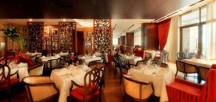 """Sinatra's restaurant combines a stylish and modern setting with a menu boasting the very best of fresh, locally-sourced ingredients. Inspired by legendary American singer and actor, Frank Sinatra, the restaurant infuses traditional and modern dishes, and pays considerable tribute to """"ol' blue eyes"""" with a wall of fame highlighting his career. Sinatra's menu emphasises a seasonal approach to European continental cuisine, and is ideal for a light lunch or a hearty dinner."""