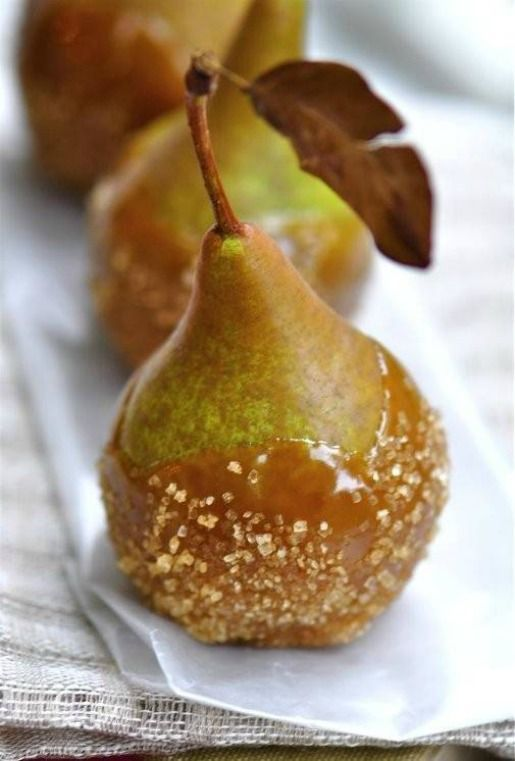 Omg @Sarah Chintomby Chintomby Land we can do carmel apple or pear favors eeeeeeee!!! Caramel Salted Pears a twist on caramel apples for the fall! Yum