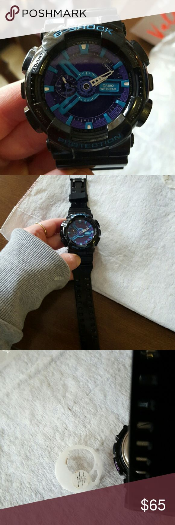 G-SHOCK WATCH FOR SALE OR TRADE ON POSH!Gorgeous black with purple and teal G-Shock watch. This is the large largest faceed watch available in the. It needed a new battery and I tried taking the back off to put the battery in myself to surprise my Husband when he came home& and then didn't remember to put it back together. Picture 3 and 4 shows that. Any watch dealer, Jeweler or jewelry store can do it for you, I just didn't want to mess around with it. A battery costs $3.Sold as is.Dont…