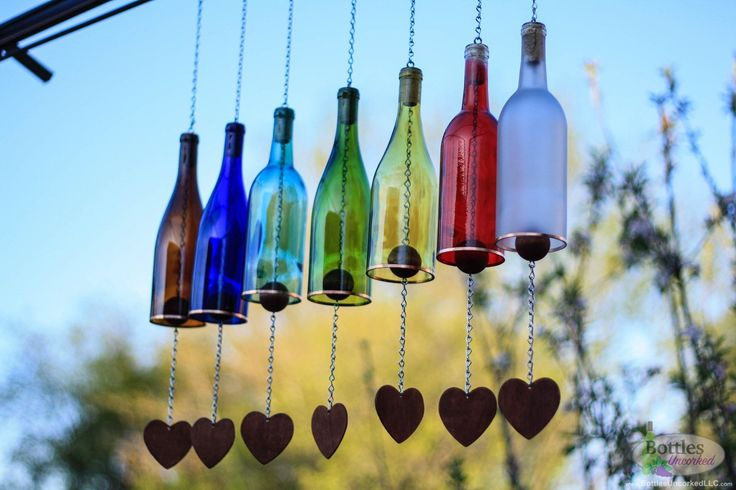 nice Colored Wine Bottle Wind Chime  Never before has the beauty of sight and sound complimented each other so perfectly. These Wine Bottle Wind Chimes are the perfect addition to any bac...