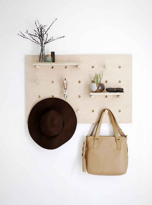 Construct a pegboard to keep your entryway organized.