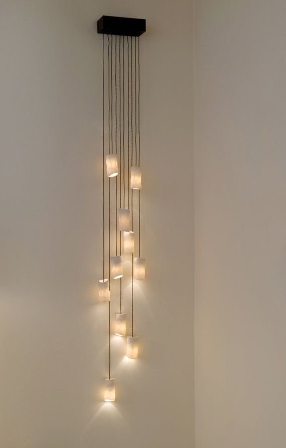 lED candles from cord on a wall 20+ Unique Wall Lamps That Steal The Show - Page 2 of 4