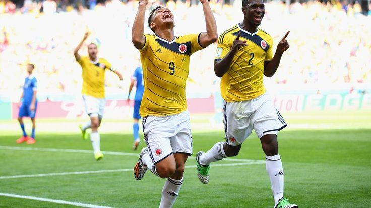 Teofilo Gutierrez of #Colombia (L) celebrates scoring his teams second goal with Cristian Zapata