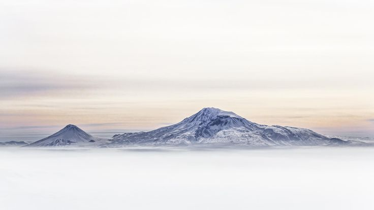 """Mount Ararat is a snow-capped, dormant volcanic cone. It has two peaks: Greater Ararat  and Lesser Arara.  Mount Ararat in Judeo-Christian tradition is associated with the """"Mountains of Ararat"""" where, according to the book of Genesis, Noah's ark came to rest."""