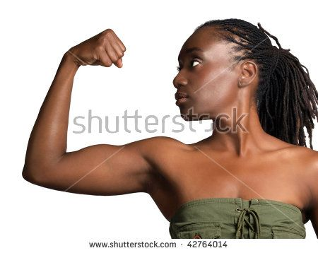 Young African American woman showing bicep muscle