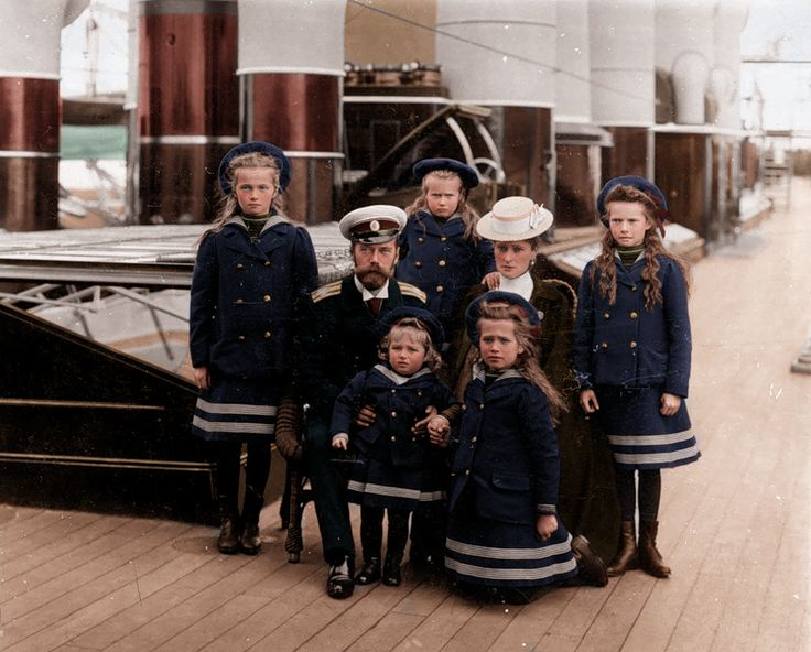 Coloured black and white photo of the Russian royal family on their yacht, the Polar Star. From left, clockwise, we have: Olga, Tsar Nicolas II, Anastasia, Tsarina Alexandra, Tatiana, Maria, and Alexei