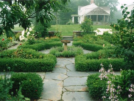 Beautiful garden path with stone bird bath centrepiece for Formal english garden designs