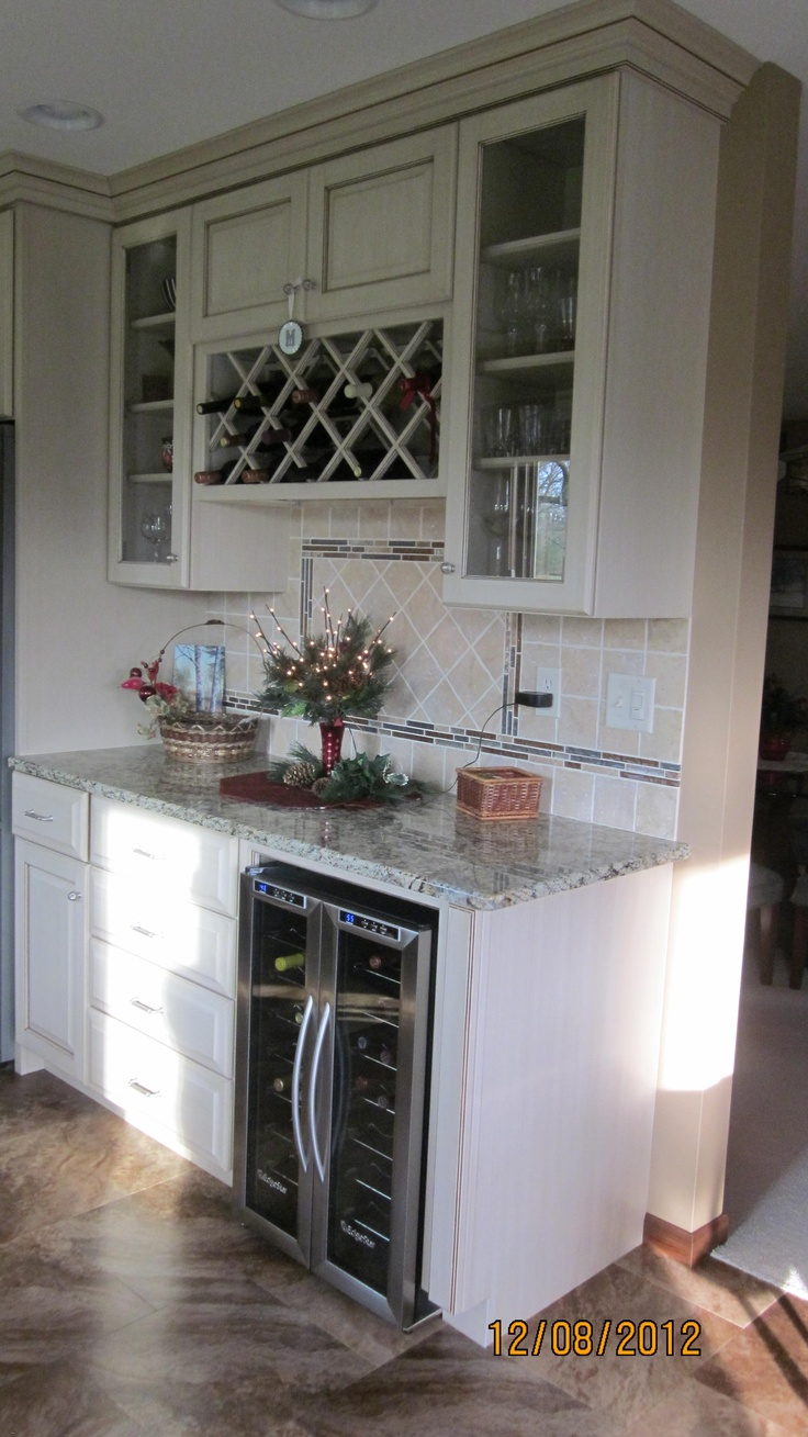 Using kitchen cabinets for bar - This Custom Wine Bar Includes A Wine Rack Glass Front Cabinets And A French Door