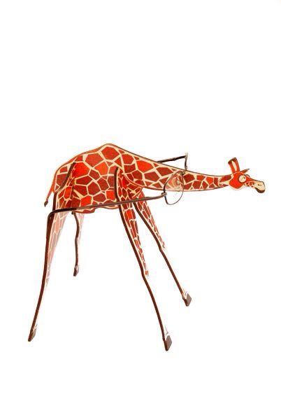 #display made of #wood #giraffe #glasses #frame #creative #design #optical