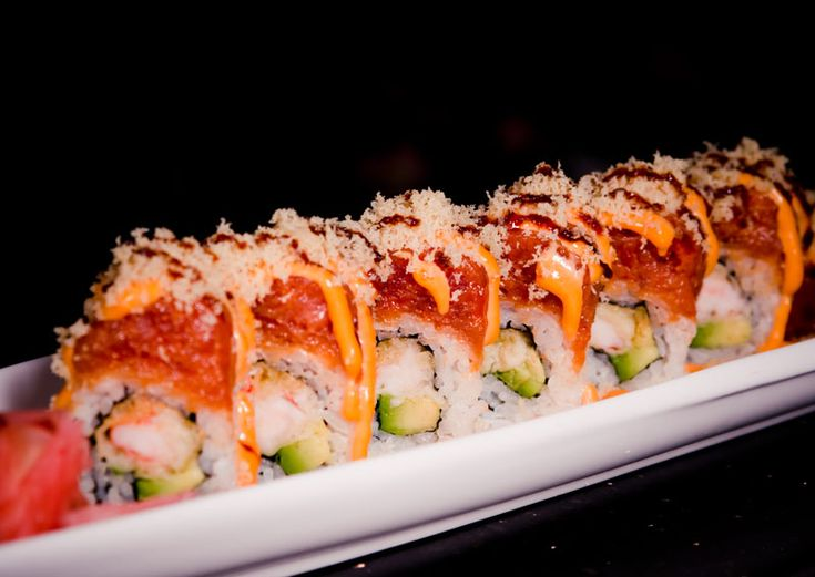 VOLCANO ROLL. Shrimp tempura and avocado -- topped  with spicy tuna, tempura flakes and lines of creamy chipotle mayonnaise.