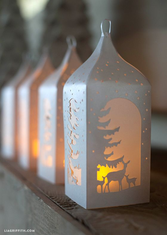 I love how these pretty diy woodland paper lanterns look on my mantel. Free printable pattern on my site.