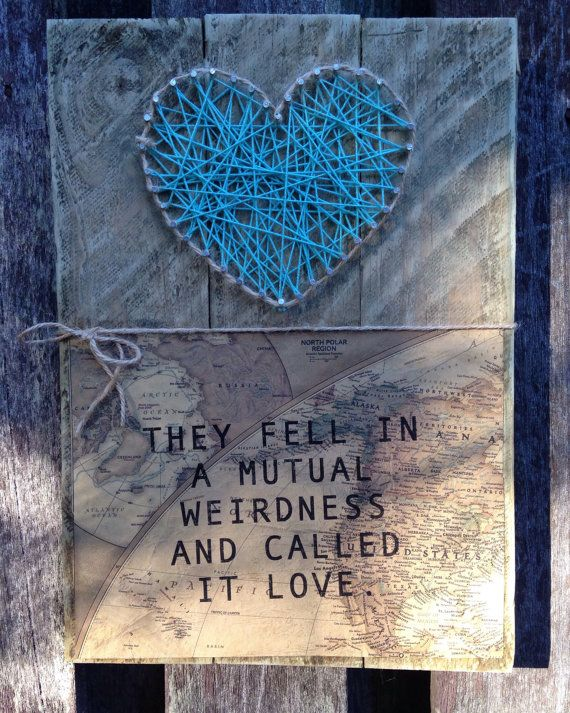 """Love Quote  """"They fell in mutual weirdness and called it love""""  100% Hand made This piece is unique in everyway and it is a one of a kind.  Makes for the perfect gift or something to add to your home. Made with unique threads and recycled timber.   Wall hanging 22cm x 32cm"""