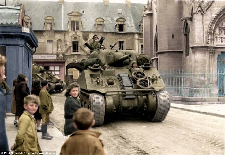 The M4 Sherman, officially named the Medium Tank M4, was the most widely used medium tank by the United States and the Western allies in the Second World War. The M4 Sherman proved to be reliable, relatively cheap to produce, and possible to create in great numbers. Pictured above is a British Army Sherman during the campaign to liberate Normandy in 1944. These old photographs have been brought back to life after being painstakingly colourised by design engineer Paul Reynolds, 48, from…