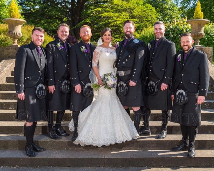 Austin Burke is pictured here with his new wife and all his groomsmen! All the men wore Dark Island kilts, with Austin in a Prince Charlie jacket and vest and matching Dark Island plaid to stand out from his groomsmen who wore Argyll jackets. Plaids are a great way to ensure you stand out on your #wedding day. #macgregorandmacduff #kingsofkilts #kingofkilts #scottish #wedding #glasgow #highlandwear #menswear #mensstyle