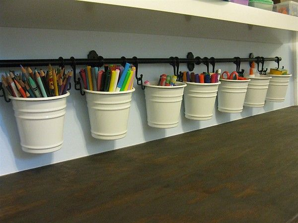 An easy and pretty way to store art stuff. I love that we can easily remove the buckets b/c they hang on hooks. Yay for Fintorp from Ikea.