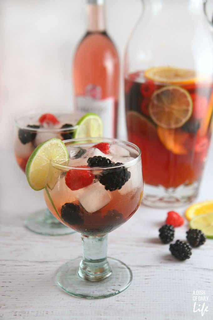 """This Pomegranate Berry Sangria Spritzer recipe is a delicious refreshing and """"lightened up"""" version of a traditional sangria...perfect for casual entertaining!"""