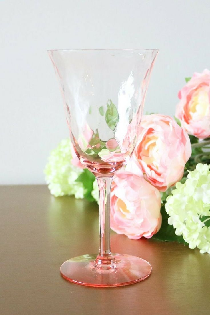 Beautiful and delicate set of 5 vintage pink champagne glasses with swirl bowls. Delicate and light, these glasses are perfect for serving champagne and champagne cocktails at a hosted girls' brunch or dinner party. They will be the talk of your party!   And with Valentine's Day coming these champagne flutes make a great gift for the wife or girlfriend.