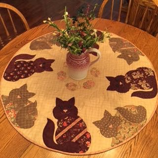"~36"" diameter. Pattern to create this adorable table topper. Eight napping and 'catty' kitties contemplating that circle of mice in the center is just too cute. Stacked appli-quilt (applique while qui"