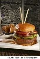 One expensive burger was created in 2006 at the Old Homestead Steakhouse in Boca Raton, Florida. Called the Tri-Beef Burger, this is made of a blend of three different kinds of beef—American Prime, Japanese Wagyu and Argentine beef. The hamburger is served with signature Chipotle ketchup made with truffles and champagne. As if the beef isn't reason enough to purchase this expensive burger, the restaurant's owners donate $10 of every sale of the $125 burger to the Make-A-Wish Foundation.
