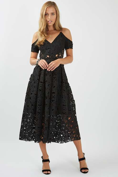 Be a princess for a night in this exquisite bardot midi prom dress. Featuring a beautiful black lace-like laser cut fabric, its peek-a-boo sides offer a contemporary touch to this classic silhouette. Pair with a strappy sandal for ultimate elegance.
