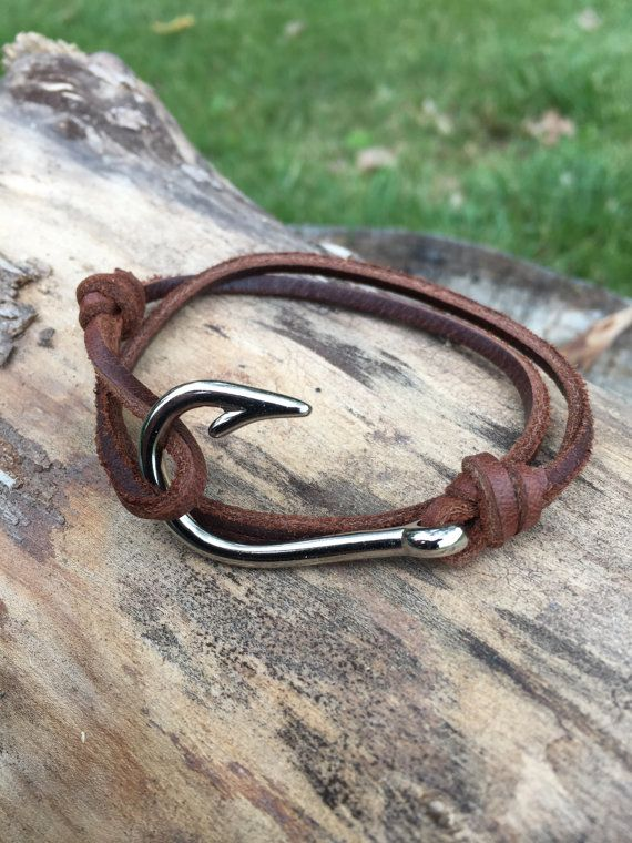 Handmade leather wrap fish hook bracelet. This custom bracelet snugly wraps twice around your wrist and fastens on the metal hook. MEASUREMENT: