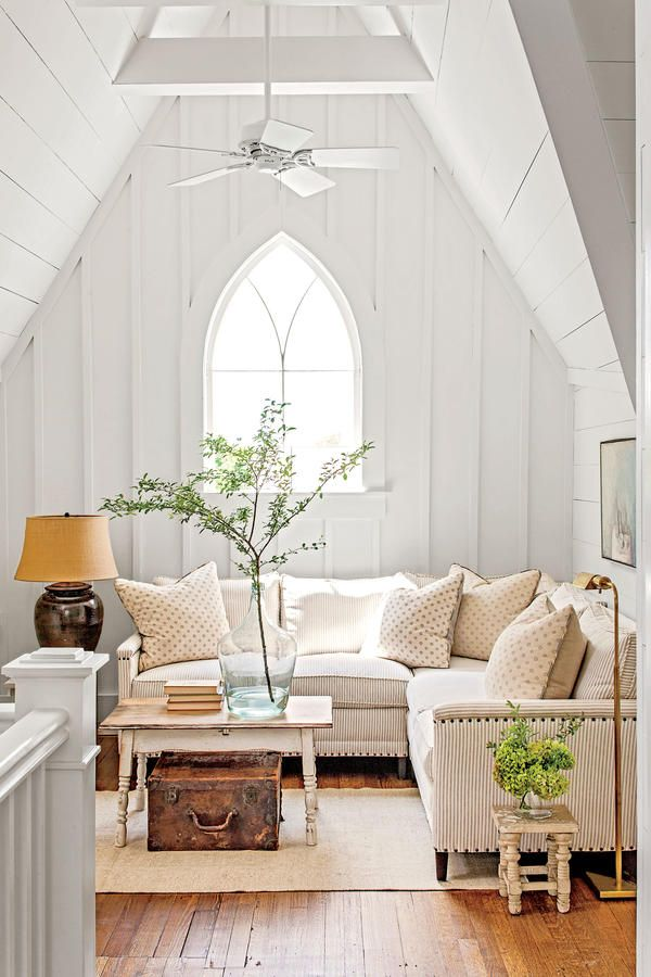 """The Loft - Charming Tennessee Mountain Cottage - Southernliving. """"You need a big landing to balance out little bedrooms,"""" says Halvorson. Here, they vaulted the ceiling and clad it with board-and-batten."""