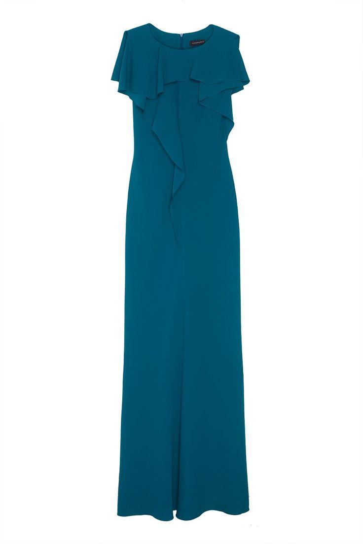 Роскошное платье в пол выполнено из струящейся бирюзовой ткани. Однотонная модель из коллекции российского бренда Chapurin – классика стиля, которая пригодится каждой, кто часто посещает светские мероприятия. Главными декоративными элементами платья служат оборки и воланы.