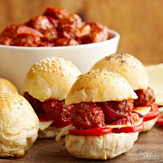 Bite-size meatball sandwiches are an adorable (and surprisingly easy!) way to get any party started. They require just 10 minutes of prep before hanging out in your slow cooker, and they're a delicious snack when nestled on cocktail buns with sliced roma tomatoes and smoky provolone cheese./