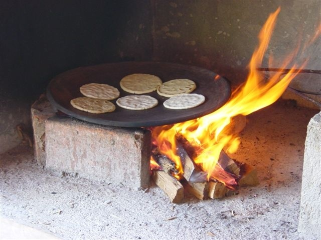 Making tortillas in a comal. A comal is a smooth, flat griddle typically used in Mexico and Central America to cook tortillas.