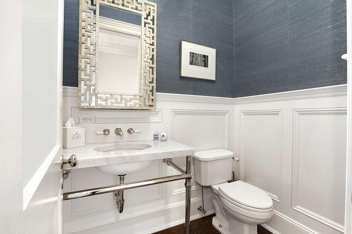 blue grasscloth wallpaper + fretwork mirror in powder room