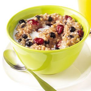 Dried cranberries and blueberries and maple syrup up the flavor of steel-cut oats.