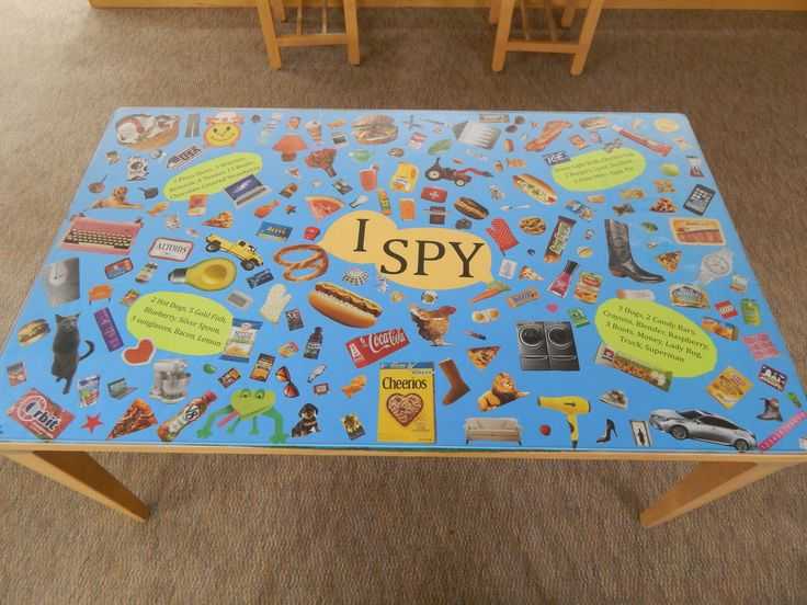 """The """"I Spy"""" table in the children's section @ Chambers County Library."""