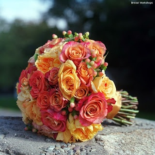 Amazing bridal bouquet made of orange and pink roses.