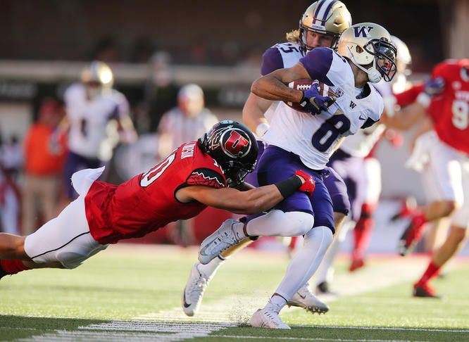 Washington Huskies wide receiver Dante Pettis (8) slips a tackle by Utah Utes defensive back Jason Thompson (10) on the punt return and scores the go ahead touchdown in Salt Lake City on Saturday, Oct. 29, 2016. Washington won 31-24.