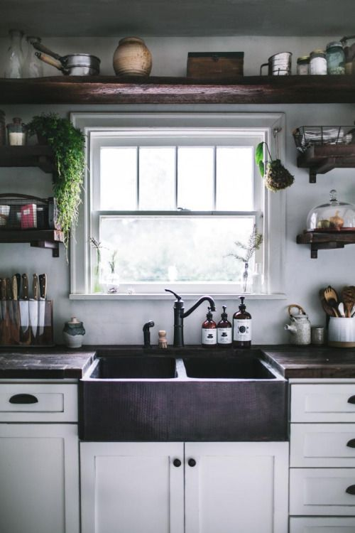 (Love the white cabinets and the slate sink with the dark wood countertops.)