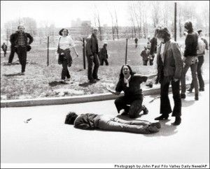 """Kent State; John Paul Filo, 1970  The Kent State protest in Ohio at the news that President Nixon was sending troops into Cambodia drew the presence of the Ohio National Guard, who turned on the crowd and fired, killing four. The horrible image of a young woman crying in anger over the dead body of a student won a Pulitzer Prize for John Filo. The event inspired Neil Young to write the protest song """"Ohio."""""""