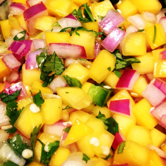 Homemade mango salsa  2 mangoes diced 2 jalapeños diced 1/2 red onion diced 1/2 cup cut up cilantro Juice from 2 limes  Mix all together, let sit for one night. Put on salad or eat with lime flavored chips :)
