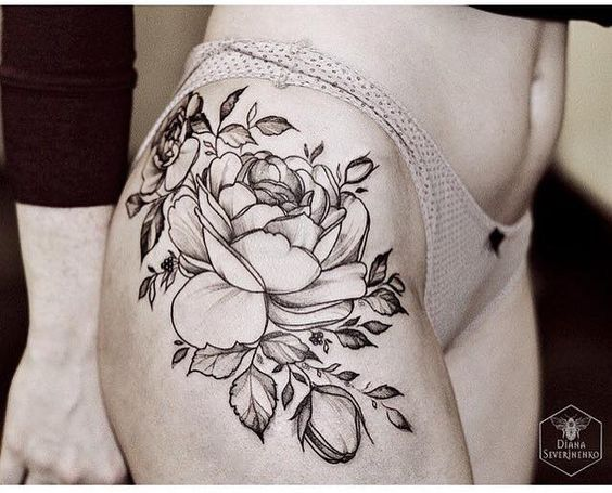 Tattoo of Flower Composition - http://www.tattooideas1.org/placement/hip/tattoo-of-flower-composition/