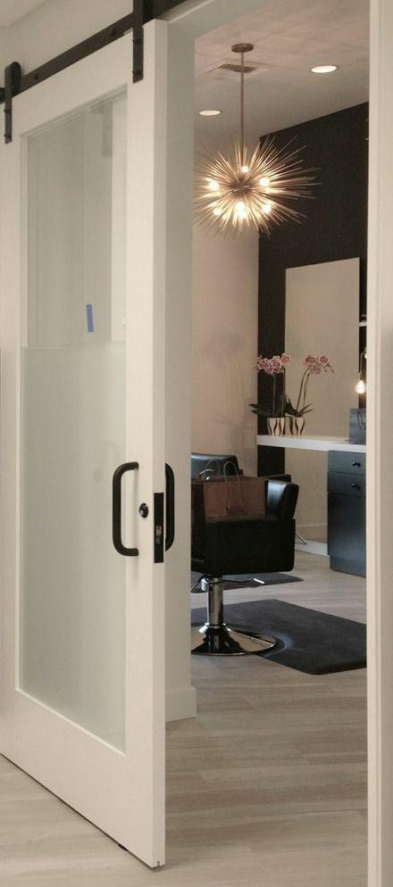 Modern barn doors, bronze hardware, hair salon