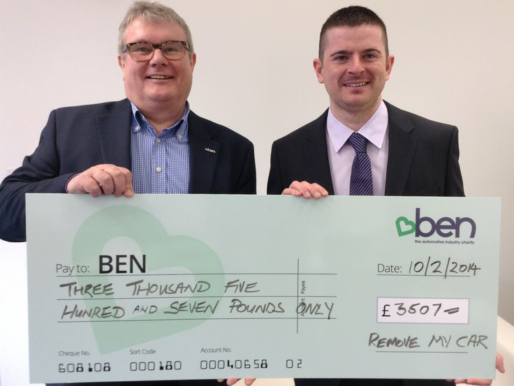 Picture with Nigel from Ben showing how much we raised in January 2014 for a fantastic charity!
