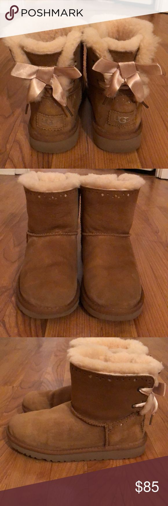 UGG MINI BAILEY BOWS UGG MINI BAILEY BOW COLOR: CHESTNUT SIZE 5 (will fit up to size 7) SATIN BOWS  CUT OUT DESIGN ***some light water staining, can not tell when worn,easily cleaned with ugg cleaner*** GREAT CONDITION UGG Shoes Winter & Rain Boots